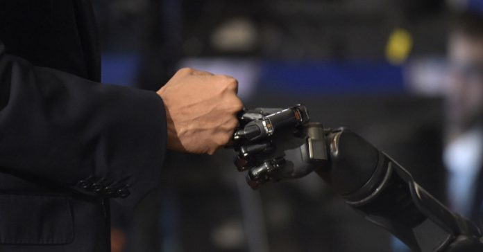 Nathan Copeland brain-controlled robotic arm sense of touch